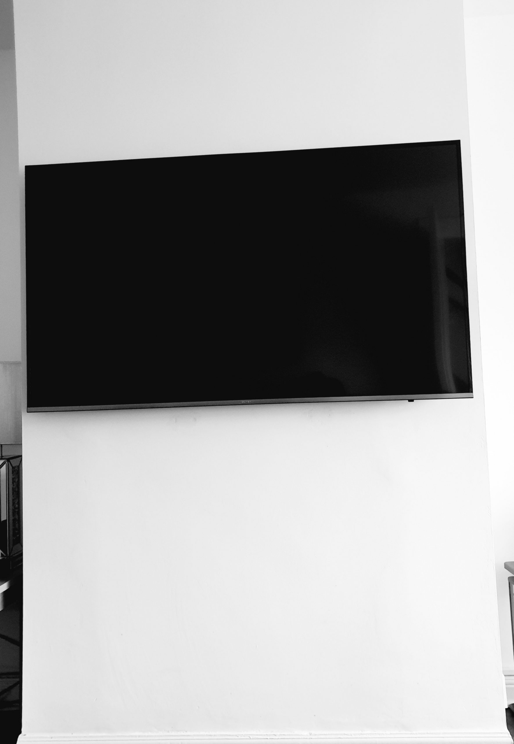 FreeSat Satellite installed on side of wall with cabling
